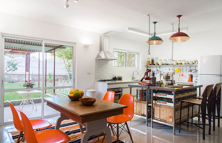 Colorful pendants and dining table chairs enliven this Tel Aviv kitchen [From: Peled Studios]