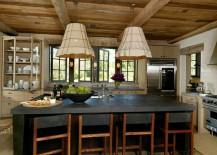 Dark kitchen island adds elegance to the rustic kitchen