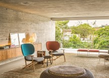Concrete and raw wood shape the cozy living room