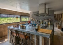 Concrete-and-wood-come-together-in-this-Dutch-kitchen-217x155