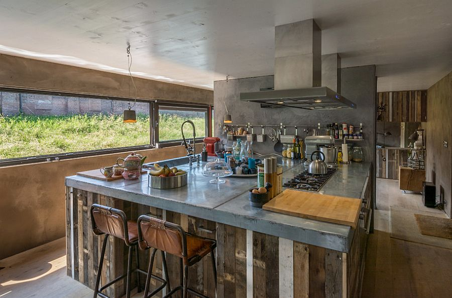 Concrete and wood come together in this Dutch kitchen [Design: Spruyt Arkenbouw]