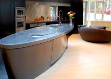 Trendy oval kitchen island with concrete countertop