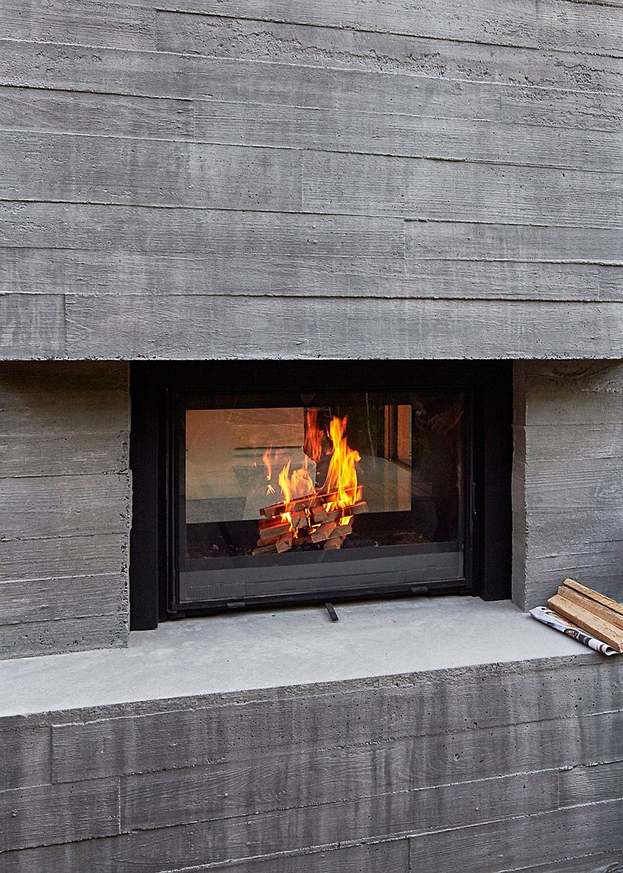 Concrete exterior of the modern home with a smart fireplace