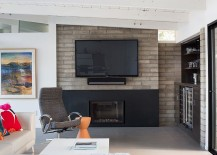 Concrete fireplace block brings  ahint of Midcentury charm to the interior