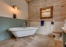 Contrasting textures and materials shape the bathroom walls