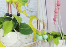 Copper pipe plant hangers from A Beautiful Mess 217x155 12 Fabulous Summer DIY Projects