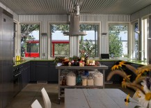 Corrugated metal adds a unique dimension to this kitchen and family space [Design: Wheeler Kearns Architects]