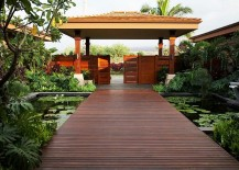 Create a stunning entrance with serene pond and a stunning walkway [Design: Willman Interiors / Gina Willman]