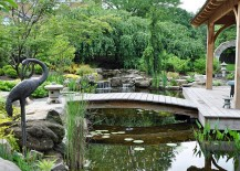 Custom Asian landscape design with waterfall, pond and a bride leading to the pavilion