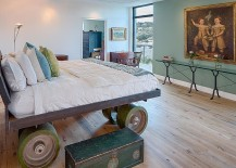 Custom bed on giant wheels steals the show in this eclectic bedroom