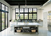 Custom-stainless-cabinetry-and-island-shape-this-cool-kitchen-217x155