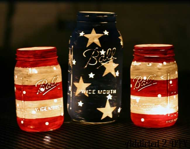 DIY Painted Red White and Blue Mason Jars Lit Up at Night
