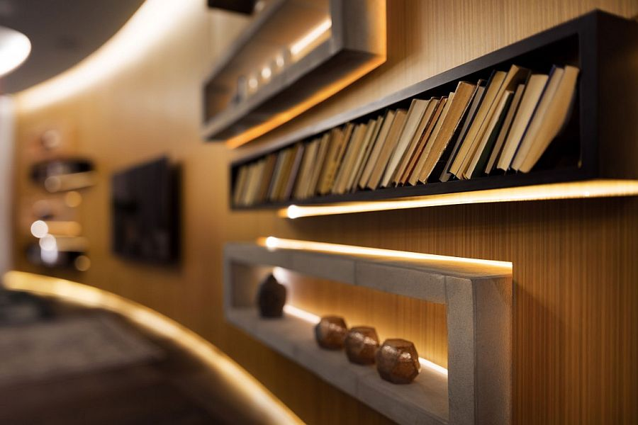 Dark sleek shelves with LED lighting in the living space