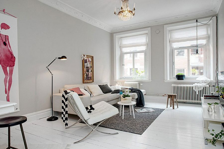 Decor in white complements the color scheme of the apartment Embracing Scandinavian Simplicity: Cozy Chic Apartment in Gothenburg