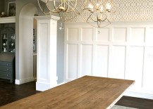 Dining room with a coffered ceiling and large pendant lights