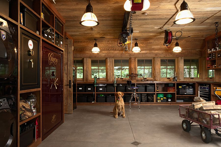Distinct Holophane lights bring an air of authenticity to the industrial garage [From: Murphy & Co. Design]