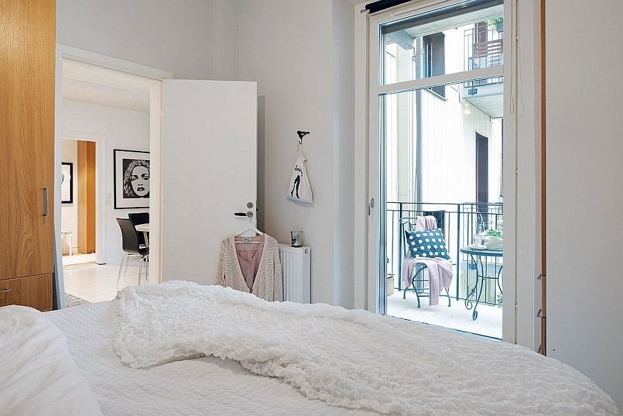 Elegant bedroom with a small balcony and minimalist design