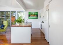 Elegant kitchen island with wooden worktop