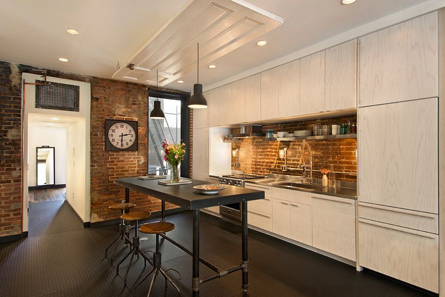 Elegant kitchen with a lovely brick wall backsplash [Design: Bennett Frank McCarthy Architects]