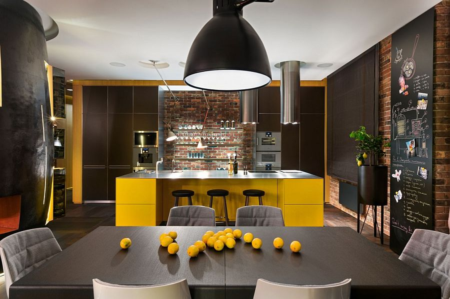 Elegant use of yellow and black in the kitchen along with a brick wall