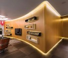 Exquisite Kiev apartment with curved wooden wall and brilliant LED strip lighting