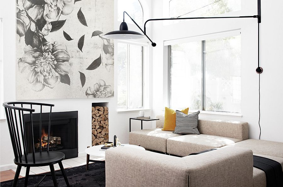 Exquisite living room in black and white with a fireplace [Design: Studio Revolution]