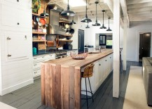 Extended-wooden-island-top-acts-as-the-perfect-breakfast-nook-217x155