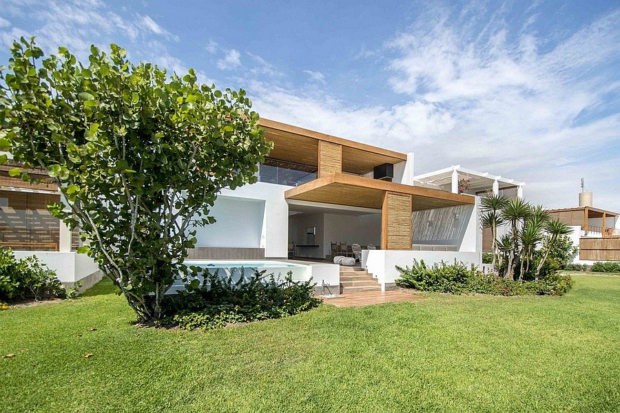 Exterior of the stylish Peru home in white has a breezy ambiance