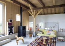 Fireplace-Eames-stools-and-a-beuatiful-rug-define-this-lovely-Scandinavian-living-room-217x155