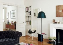 Floor lamp and stylish seating next to the fireplace shape the reading noodk