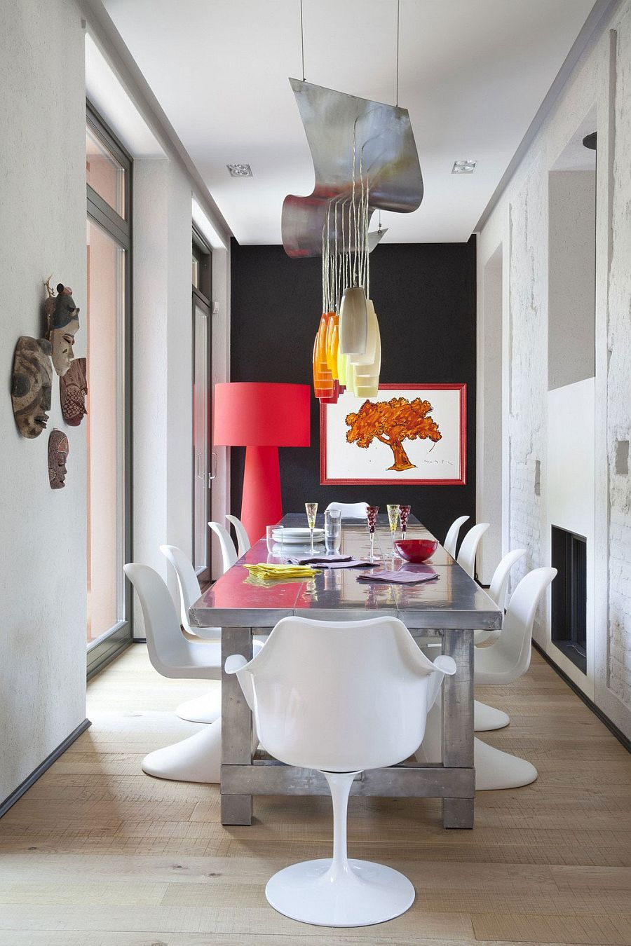 Formal dining area gets a colorful, fun twist inside this eclectic Italian home