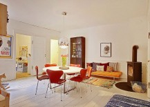 Formal-dining-space-of-the-Scandinavian-apartment-with-midcentury-chairs-217x155