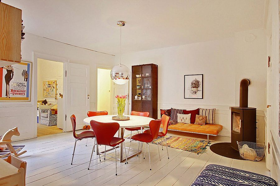 Formal dining space of the Scandinavian apartment with midcentury chairs