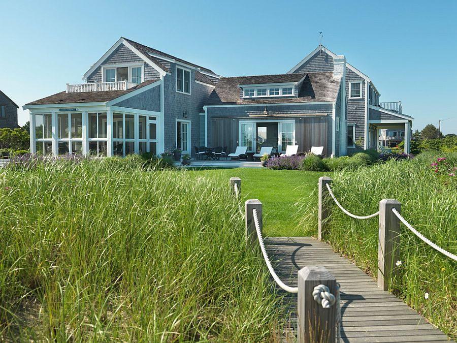 Garden bridge that complements the beach style of the home [Design: Donna Elle Seaside Living]
