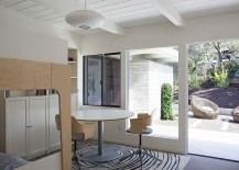 George Nelson lamp and sliding glass doors shape the interior