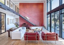 Gorgeous red accent wall for the large, open living room with Lake Austin views