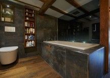 Gorgeous use of dark tones and intriguing textures in the rustic bathroom [Design: MillChris Developments]
