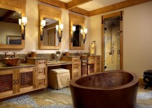 Hand-hammered bathtub steals the show in this warm, inviting bathroom [Design: Zabala Erickson]