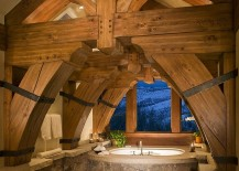 Heavy-timber-frame-dominates-the-visual-in-this-cool-rustic-bathroom-217x155