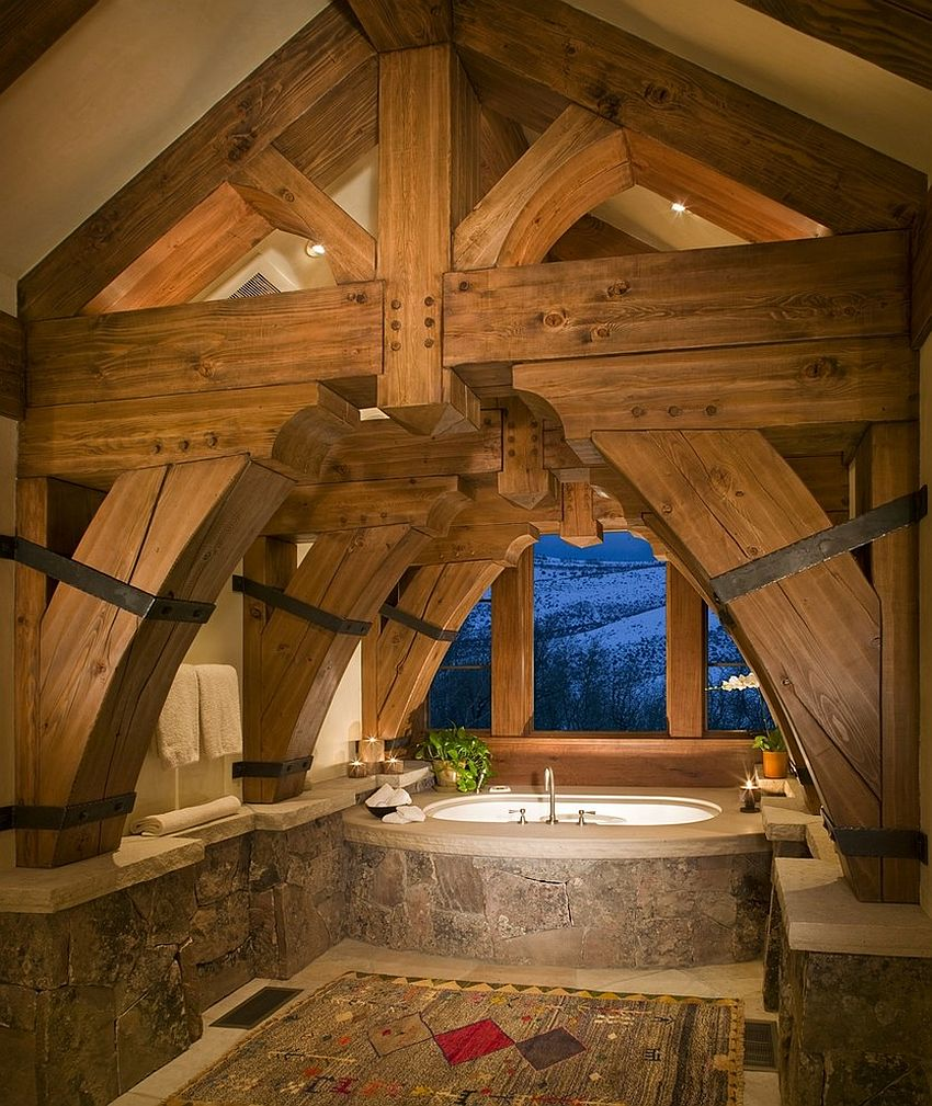 Heavy timber frame dominates the visual in this cool rustic bathroom [Design: RMT Architects / Living Images Photography]