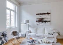 Herringbone pattern flooring stands out in the white living room [From: Sven Fennema - Living Pictures]