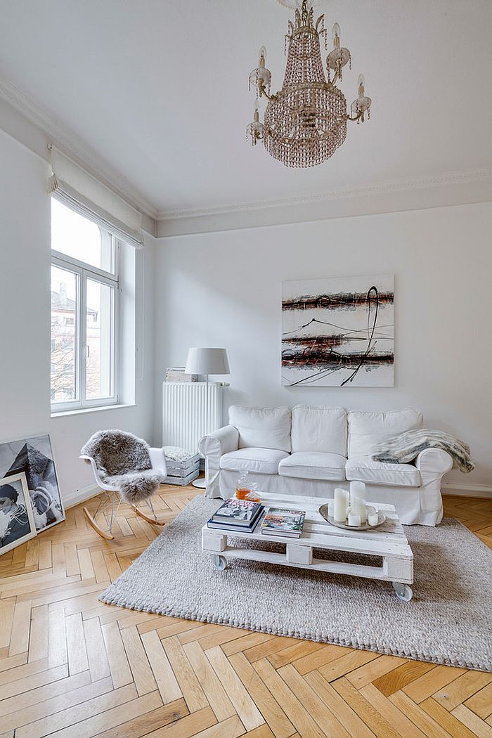 Herringbone pattern flooring stands out in the white living room [From: Sven Fennema – Living Pictures]
