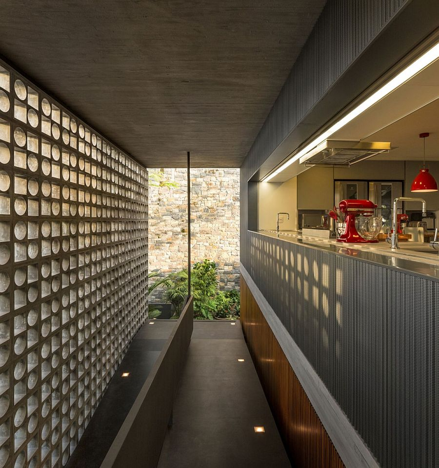 Hollowed-out concrete elements allows light to filter through into the kitchen