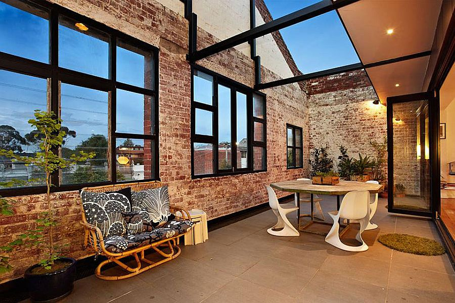Industrial style courtyard of the Melbourne home with brick walls