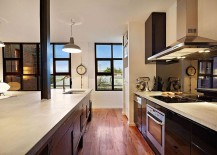 Industrial style windows and lighting shape the interior