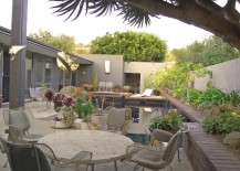 Interesting containers fill this poolside patio
