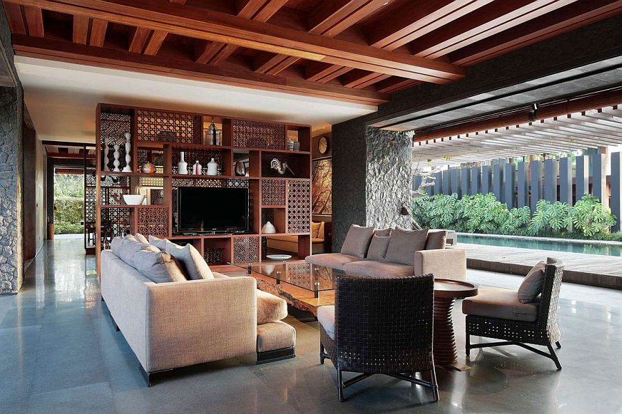 Intricate wooden shelves add to the beauty of the living room