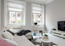 Large windows bring in ample light indoors 217x155 Embracing Scandinavian Simplicity: Cozy Chic Apartment in Gothenburg