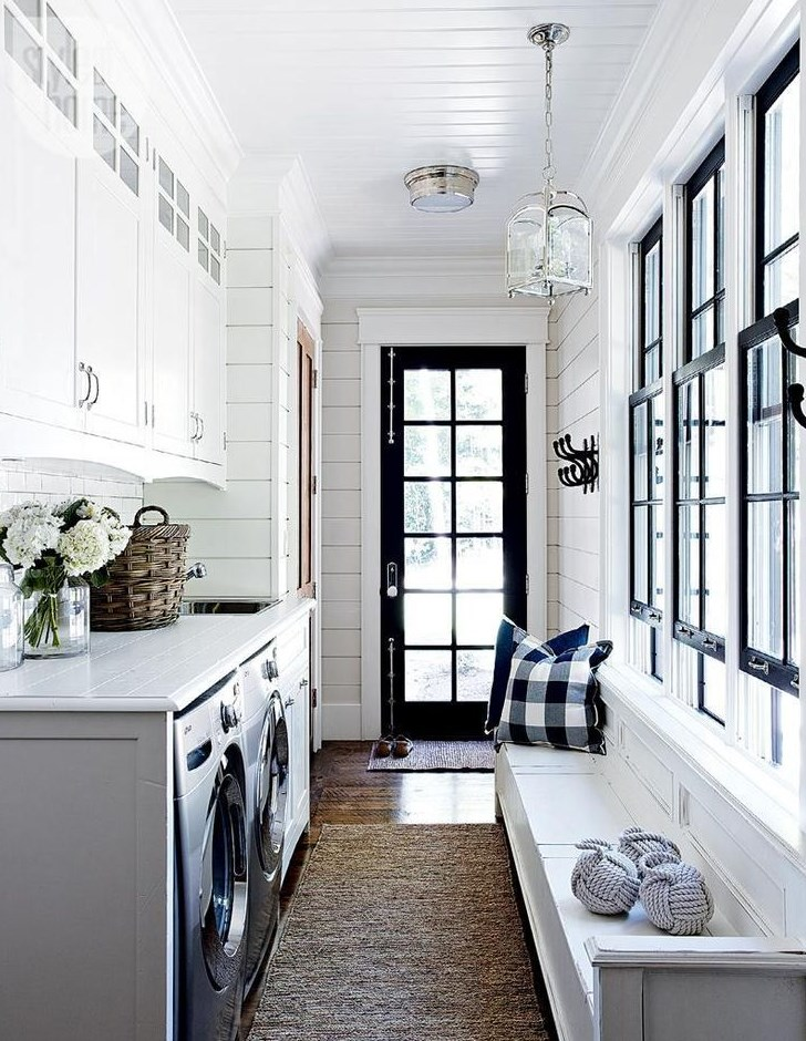 Laundry room with black door and window trim