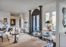 Living-room-with-black-door-frame-and-columns-217x155
